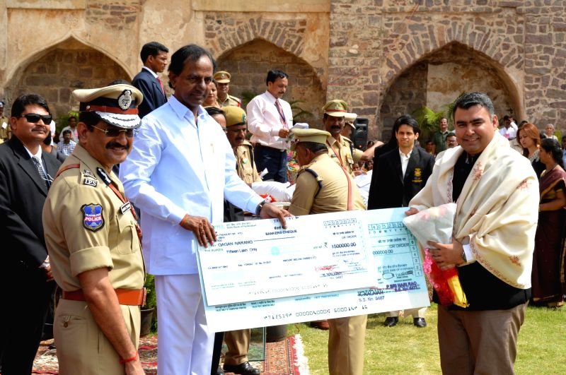 Telangana Chief Minister K Chandrasekhar Rao presents a cheque to Indian marksman Gagan Narang during 68th Independence Day celebrations at Golkonda Fort, some 11 km away from Hyderabad on Aug 15, ... - K Chandrasekhar Rao