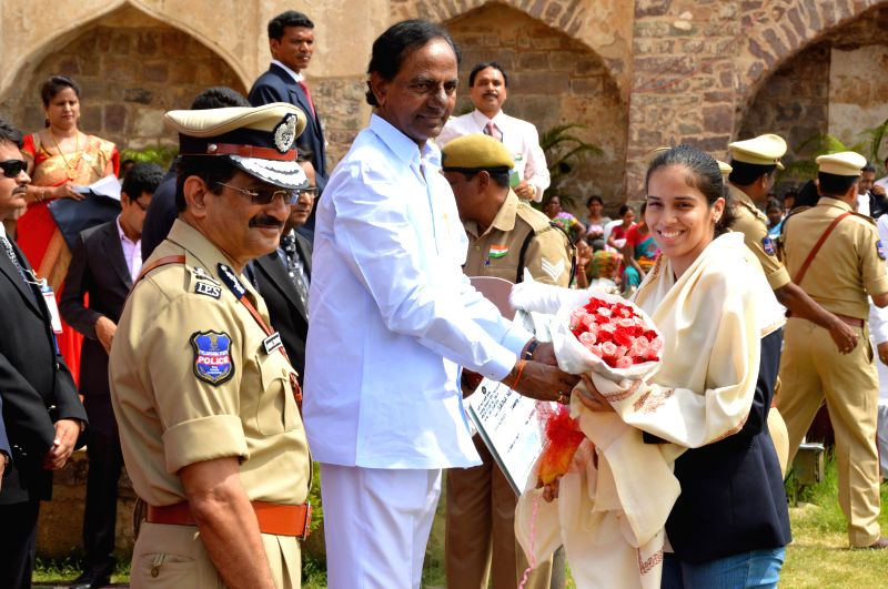 Telangana Chief Minister K Chandrasekhar Rao presents a cheque to Indian badminton player Saina Nehwal during 68th Independence Day celebrations at Golkonda Fort, some 11 km away from Hyderabad on ... - K Chandrasekhar Rao
