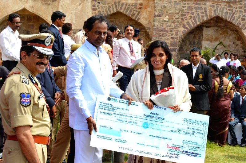 Telangana Chief Minister K Chandrasekhar Rao presents a cheque to Kabaddi player Mamata Pujari during 68th Independence Day celebrations at Golkonda Fort, some 11 km away from Hyderabad on Aug 15, ... - K Chandrasekhar Rao