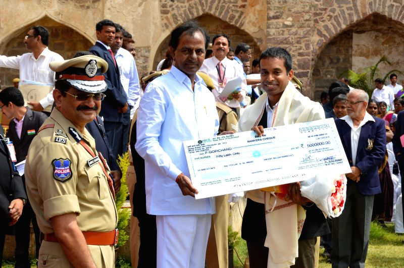 Telangana Chief Minister K Chandrasekhar Rao presents a cheque to former Indian badminton player Pullela Gopichand during 68th Independence Day celebrations at Golkonda Fort, some 11 km away from ... - K Chandrasekhar Rao