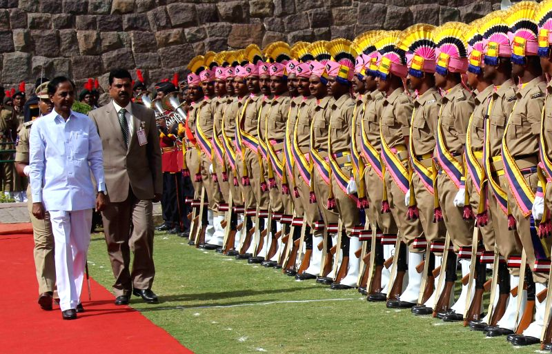 Telangana Chief Minister K Chandrasekhar Rao inspects Guard of Honour during 68th Independence Day celebrations at Golkonda Fort, some 11 km away from Hyderabad on Aug 15, 2014. - K Chandrasekhar Rao
