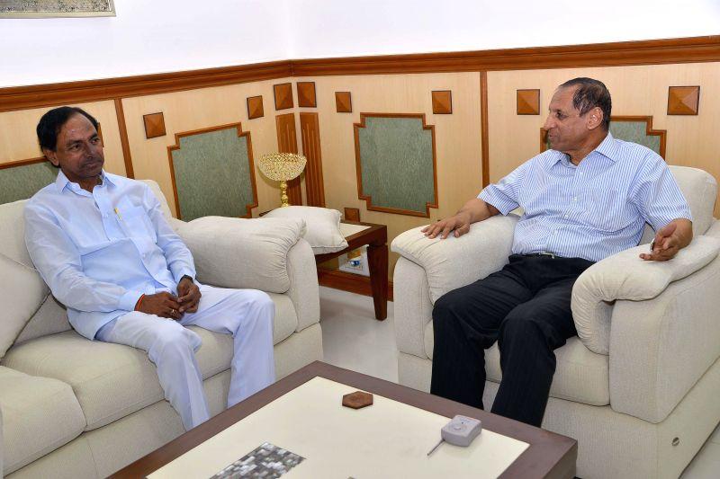 Telangana Chief Minister K Chandrasekhar Rao during a meeting with Telangana Governor E. S. L. Narasimhan at Raj Bhawan in Hyderabad on Aug 28, 2014. - K Chandrasekhar Rao