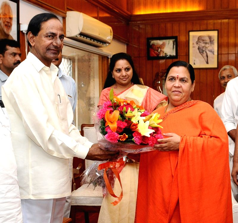 Telangana Chief Minister K Chandrasekhar Rao calls on the Union Minister for Water Resources, River Development and Ganga Rejuvenation Uma Bharti, in New Delhi on July 18, 2016. - K Chandrasekhar Rao