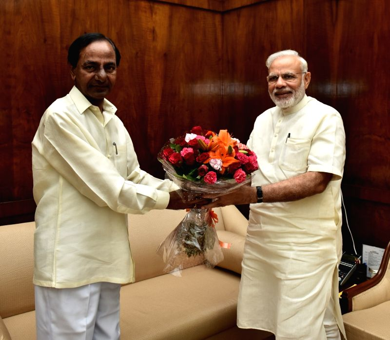 Telangana Chief Minister K Chandrasekhar Rao calls on Prime Minister Narendra Modi, in New Delhi on July 18, 2016. - K Chandrasekhar Rao and Narendra Modi