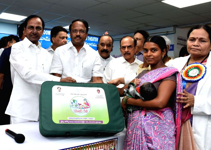 "Telangana Chief Minister K Chandrasekhar Rao presents ""KCR Kits"" to new mothers during a programme in Hyderabad on June 3, 2017. - K Chandrasekhar Rao"
