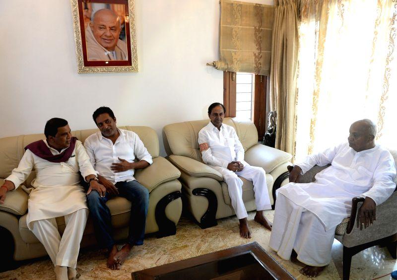 Telangana Chief Minister K Chandrasekhar Rao and actor Prakash Raj meet JD(S) supremo H. D. Deve Gowda at his residence in Bengaluru, on April 13, 2018. - K Chandrasekhar Rao