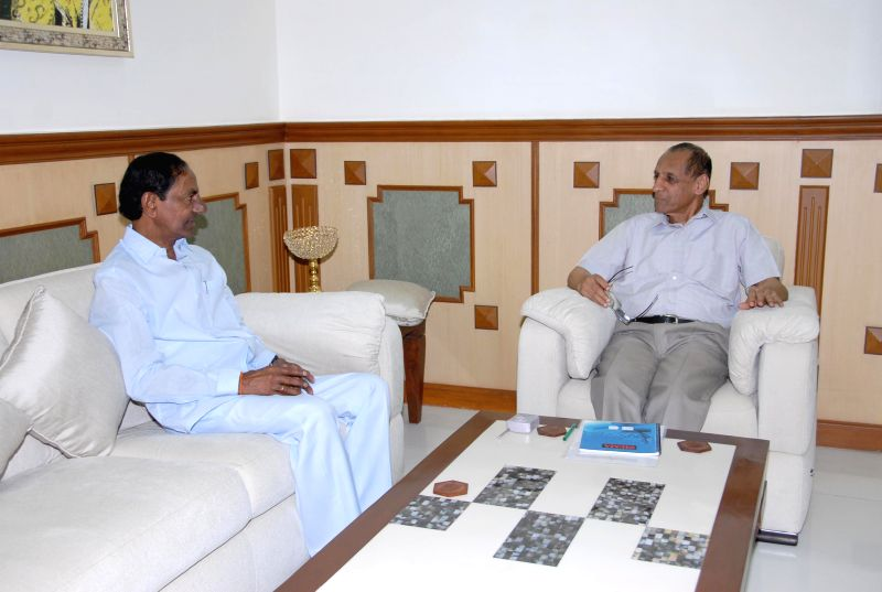 Telangana Chief Minister K Chandrasekhar Rao with the Governor of Telangana E S L Narasimhan during a meeting at Raj Bhavan in Hyderabad on June 24, 2014. - K Chandrasekhar Rao