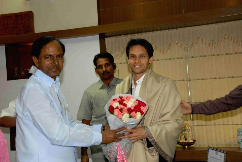 Telangana Chief Minister K Chandrasekhar Rao with Indian shuttler Parupalli Kashyap during a meeting in Hyderabad on Aug 6, 2014. - K Chandrasekhar Rao and Parupalli Kashyap