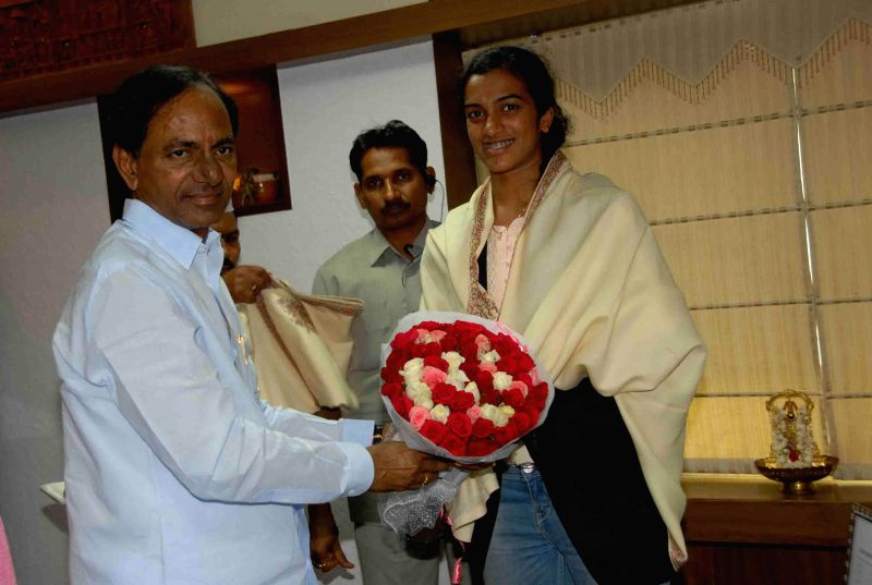 Telangana Chief Minister K Chandrasekhar Rao with Indian badminton player P. V. Sindhu  during a meeting in Hyderabad on Aug 6, 2014. - K Chandrasekhar Rao