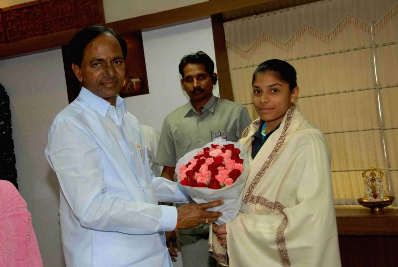 Telangana Chief Minister K Chandrasekhar Rao with Indian Gymnastic player Aruna Reddy during a meeting in Hyderabad on Aug 6, 2014. - K Chandrasekhar Rao and Aruna Reddy
