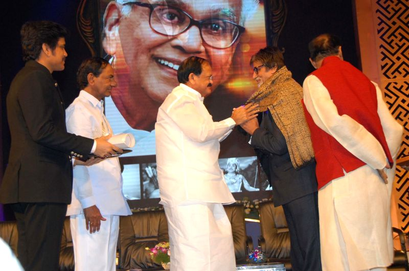 Telangana Chief Minister K. Chandrashekar Rao and Union Minister Venkaiah Naidu presenting Akkineni Nageswara Rao Award - 2014 to superstar Amitabh Bachchan at Annapurna studios in Hyderabad on Dec. . - K. Chandrashekar Rao, Venkaiah Naidu and Amitabh Bachchan