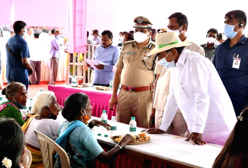 Telangana CM lunches with people in adopted village