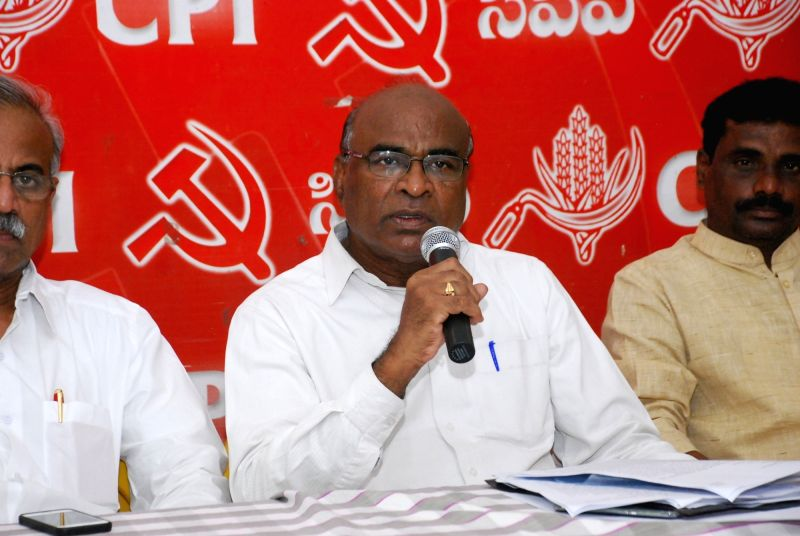 Telangana Communist Party of India (CPI) secretary Chada Venkata Reddy (C) addresses a press conference in Hyderabad on June 3, 2017. - Chada Venkata Reddy