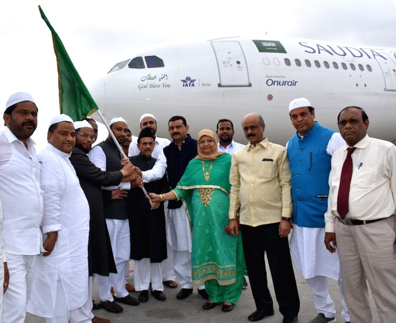 Telangana Deputy Chief Minister Mahmood Ali and Haj Committee Chairman Masihullah Khan flag off the first batch of Hajj pilgrims from Rajiv Gandhi International Airport, in Shamshabad on ... - Mahmood Ali and Masihullah Khan