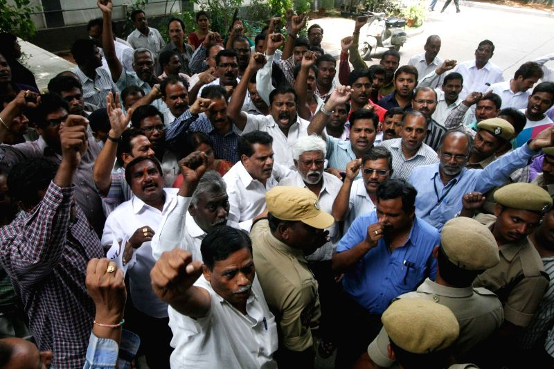 Telangana employees demonstrate outside public service commission in Hyderabad on July 3, 2014.