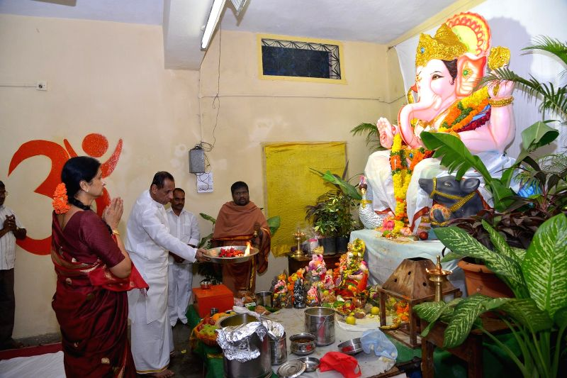 Telangana Governor E. S. L. Narasimhan worships lord Ganesh at Raj Bhavan in Hyderabad on Aug 31, 2014.