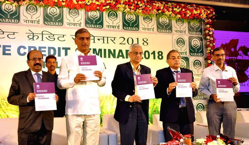 Telangana Irrigation Minister T. Harish Rao releases the state focus paper during the National Bank for Agricultural and Rural Development (NABARD) seminar in Hyderabad on Jan 30, 2018. - T. Harish Rao