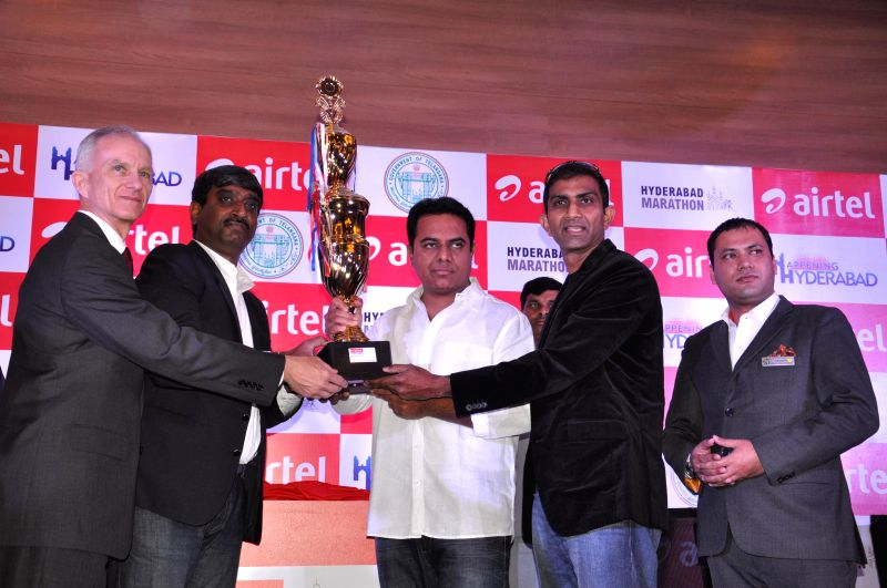 Telangana IT Minister K T Rama Rao unveils Airtel Hyderabad Marathon trophy in Hyderabad on Aug 21, 2014. - K T Rama Rao