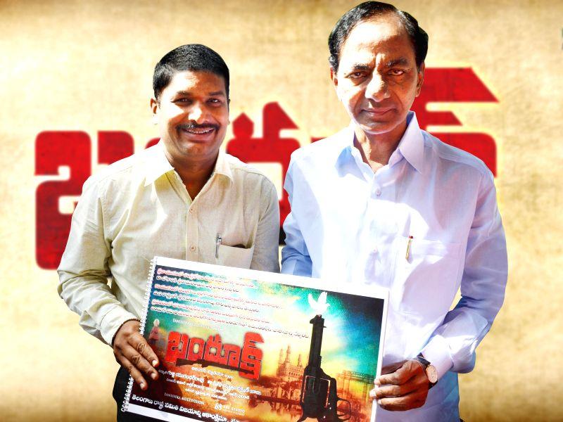 Telangana Rashtra Samithi (TRS) chief K Chandersheker Rao launches poster of upcoming film 'Bhandook' in Hyderabad. - K Chandersheker Rao