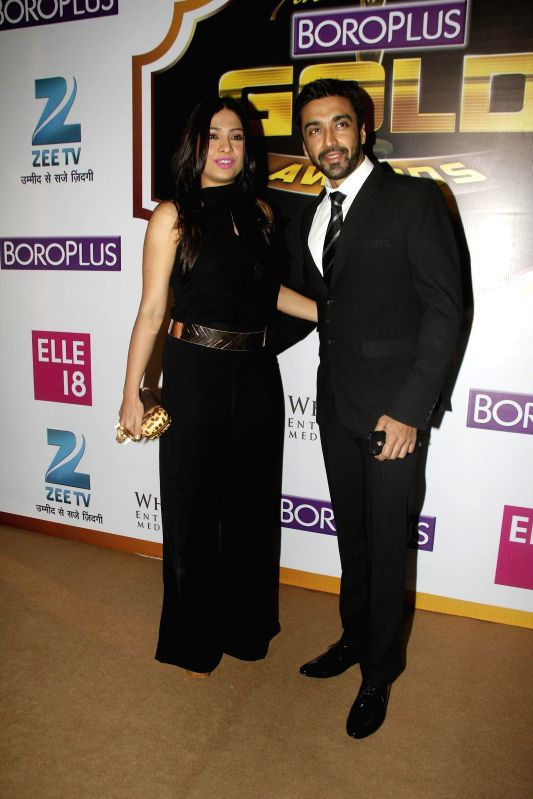 Television actor Aashish Chaudhary with his wife Samita during the 7th Boroplus Zee Gold Awards 2014 in Mumbai, on May 17, 2014. - Aashish Chaudhary
