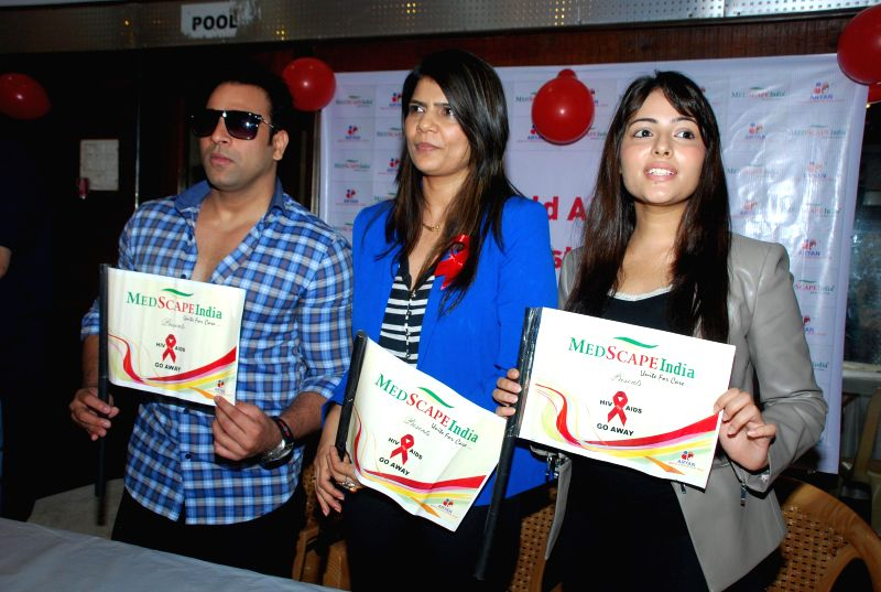 Television actor Abhishek Avasthi, Dr.Sunita Dube and Aanchal Munjal for AIDS awareness while celebrating World AIDS Day in Mumbai on Dec 1, 2014. - Abhishek Avasthi