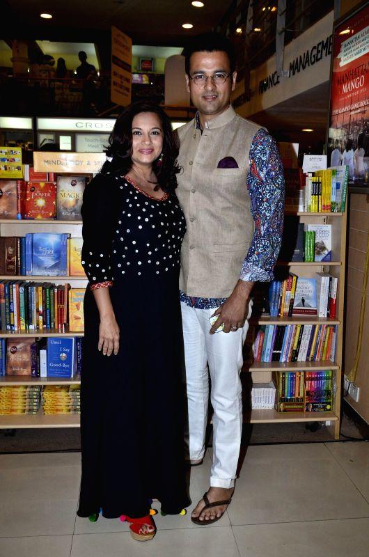 Television actor Mansi Joshi Roy and Television actor Rohit Royduring the launch of Madhuri Iyer's book Manhattan Mango in Mumbai, on July 4, 2014. - Mansi Joshi Roy