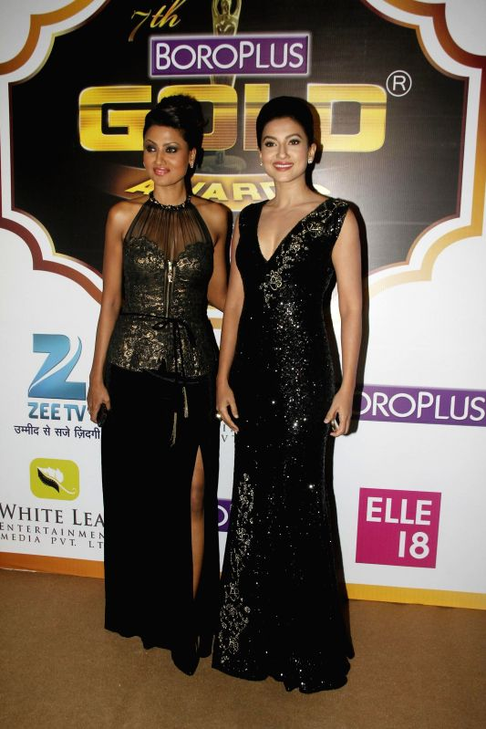 Television actor Nigaar khan and Gauhar Khan during the 7th Boroplus Zee Gold Awards 2014 in Mumbai, on May 17, 2014. - Nigaar and Gauhar Khan