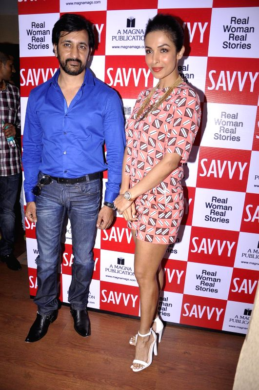 Television actor Rajeev Paul and actor Malaika Arora Khan during the unveiling of latest cover of Savvy magazine in Mumbai on July 7, 2014. - Rajeev Paul