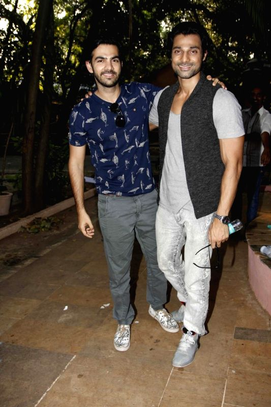 Television actors Karan Grover and Hanif Hilal during during the launch of Nisha Rawal's song, Choti si Asha, to raise funds for under privileged children in Mumbai, on Nov 13, 2015. - Karan Grover and Hanif Hilal