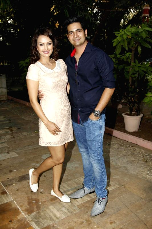 Television actors Nisha Rawal and Karan Mehra during during the launch of Nisha Rawal's song, Choti si Asha, to raise funds for under privileged children in Mumbai, on Nov 13, 2015. - Karan Mehra