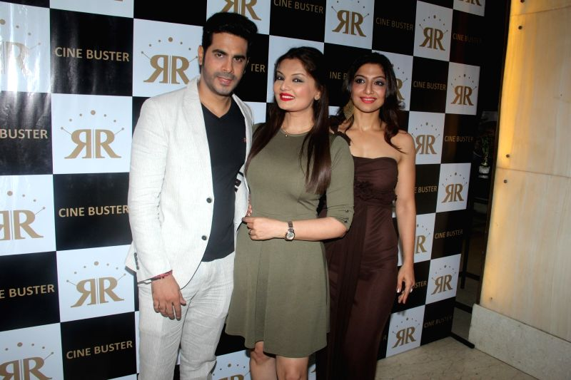 Television actress Deepshikha with husband Kaishav Arora during the launch of Cine Buster Magazine in Mumbai on June 10, 2017. - Deepshikha and Kaishav Arora