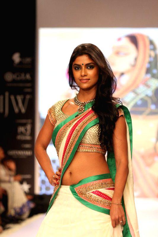 :Television actress Sayantani Ghosh walk the ramp for social cause `Beti` during Gitanjali Gems show as part of India International Jewellery Week (IIJW) in Mumbai on August 4, 2013. (Photo: IANS).