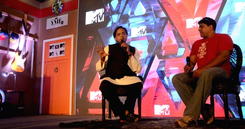Television anchor Cyrus Broacha with Union Minister of State for Human Resource Development, Shashi Tharoor during an interview in Mumbai on April 16, 2014.
