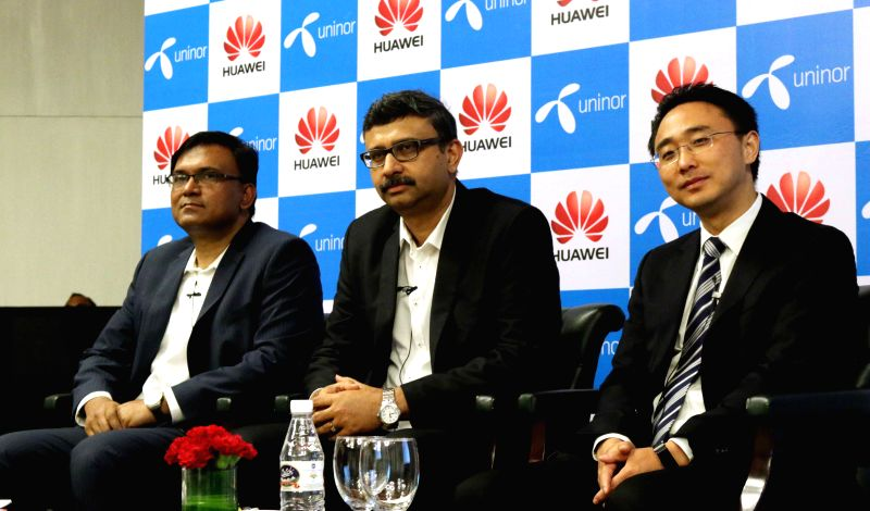 Telewings Communications Services (Uninor) COO Tanveer Mohammad, Telewings CEO Vivak Sood and Huawei's Baker Zhou during a press conference in New Delhi, on Aug 12, 2015.