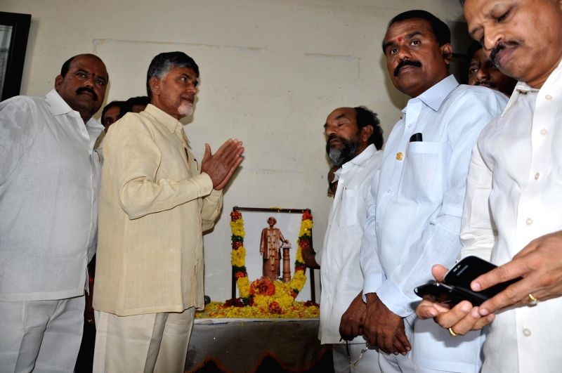 Telugu Desam Party (TDP) president N. Chandrababu Naidu during a programme organised to celebrate the birth anniversary of Jyotirao Phule at his residence in Hyderabad on April 11, 2014. - N. Chandrababu Naidu