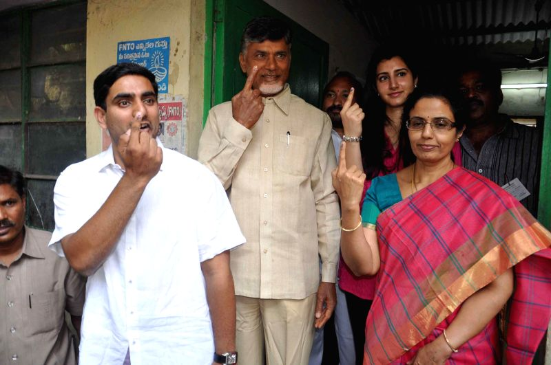 Telugu Desam Party (TDP) president N. Chandrababu Naidu shows his fore finger marked with phosphorous ink after casting his vote at a polling booth during the seventh phase of 2014 Lok Sabha Polls in