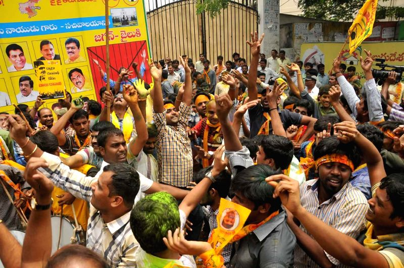 Telugu Desam Party (TDP) workers celebrate their performance in 2014 Lok Sabha elections in Hyderabad on May 16, 2014.