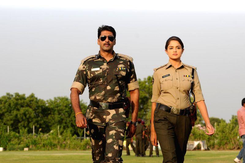 Telugu movie `Aa Aiduguru` stills.