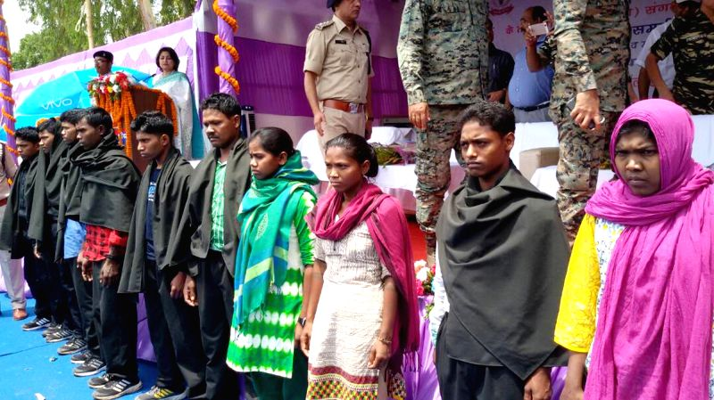 Ten Maoists surrender before police officials in Lohardaga of Jharkhand on April 26,  2017.