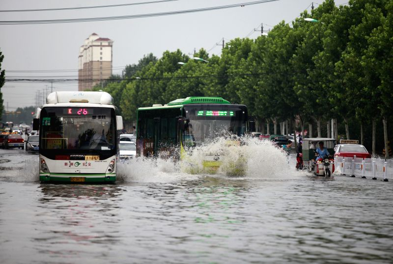 TENGZHOU, Aug. 2, 2016 - Vehicles run on a waterlogged street in Tengzhou City, east China's Shandong Province, Aug. 2, 2016. Tengzhou meteorological authorities have issued red alert for rain, the ...