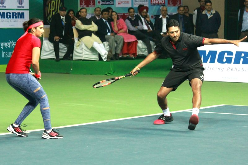 Tennis player Mahesh Bhupathi and Sania Mirza during an exhibition match in New Delhi on Nov 27, 2015.