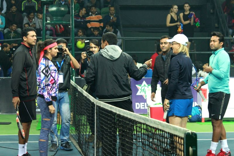 Tennis player Mahesh Bhupathi, Sania Mirza, Martina Navratilova and Leander Paes during an exhibition match in New Delhi on Nov 27, 2015.