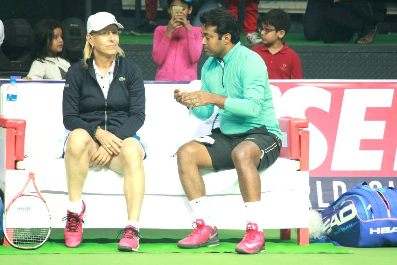 Tennis player Martina Navratilova and Leander Paes during an exhibition match in New Delhi on Nov 27, 2015.