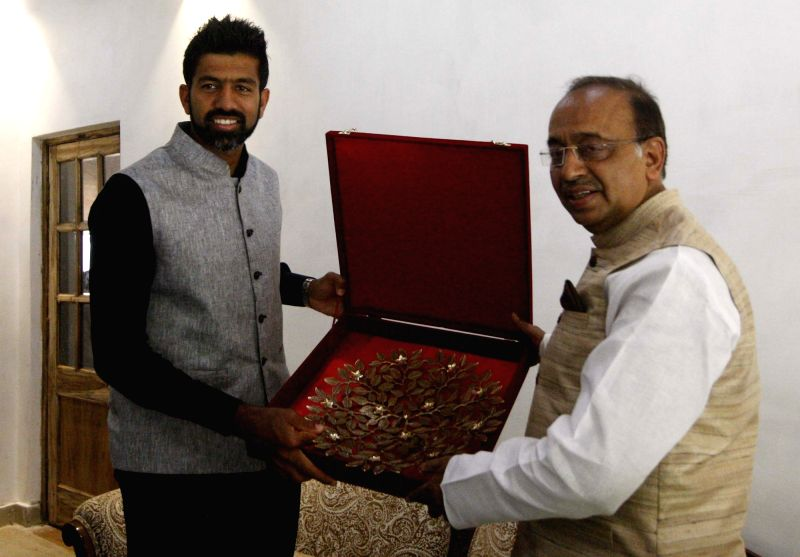 Tennis player Rohan Bopanna winner of Mixed Doubles title at recently concluded French Open calls on Union MoS for Youth Affairs and Sports Vijay Goel in New Delhi on June 14, 2017. - Rohan Bopanna