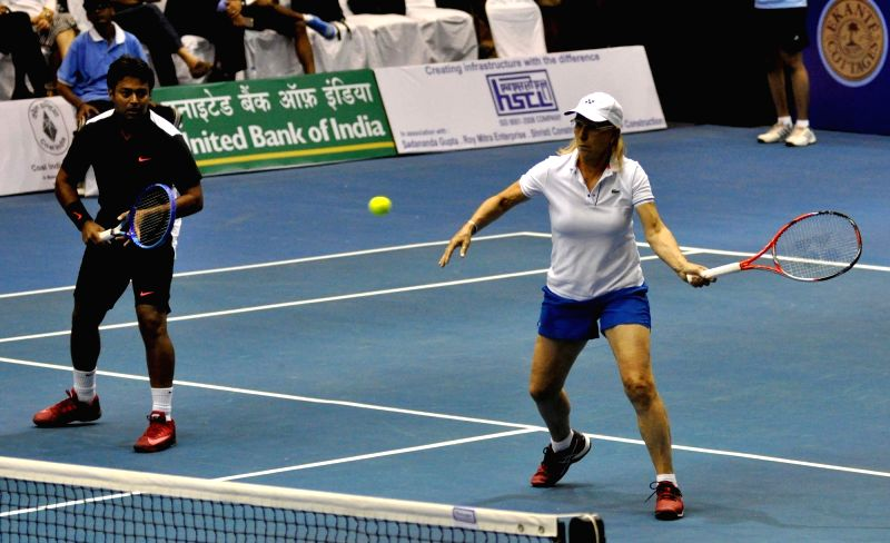 Tennis players Martina Navratilova and Leander Paes in action during a Champions Tennis League (CTL) match in Kolkata, on Nov 25, 2015.