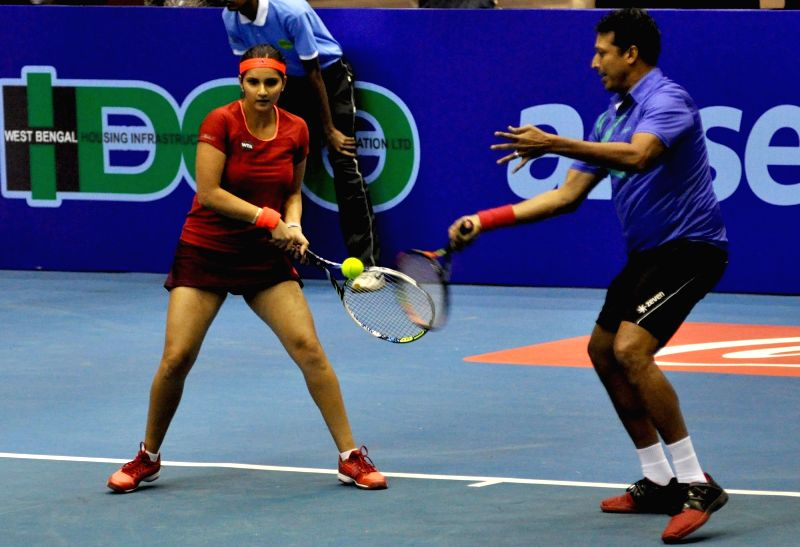 Tennis players Sania Mirza and Mahesh Bhupathi in action during a Champions Tennis League (CTL) match in Kolkata, on Nov 25, 2015.