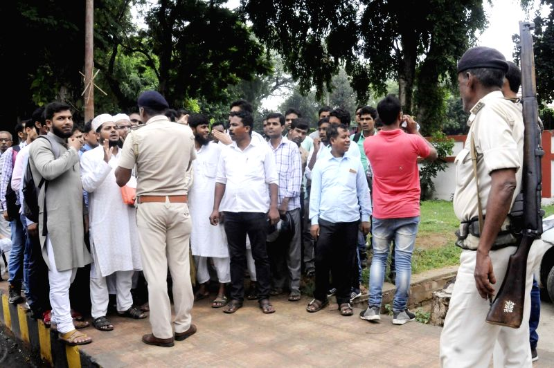 TET (Teacher Eligibility Test) candidates being stopped by the police during a demonstration to press for their various demands, in Patna on July 25, 2018.