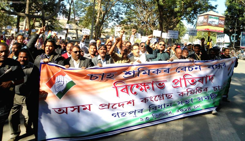 Tea Garden workers led by Congress leader Ripun Bora stage a demonstration against the Central government`s decision regarding subsidised ration to Tea Garden workers at Tezpur on Dec 23, ...