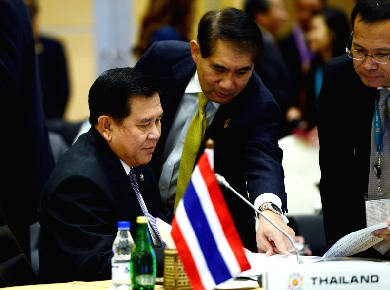 Thai Deputy Prime Minister and Foreign Minister Tanasak Patimapragorn (L) attends a session of the 48th ASEAN Foreign Ministers' Meeting in Kuala Lumpur, ... - Tanasak Patimapragorn