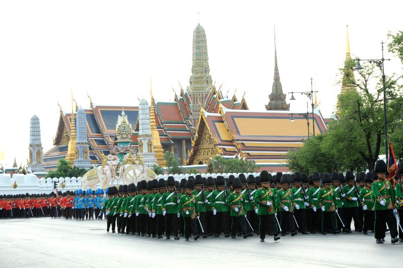 Thai soldiers attend a parade as part of the King Bhumibol Adulyadej's upcoming 88th birthday celebration outside the Grand Palace in Bangkok, Thailand, Dec. 3, ...